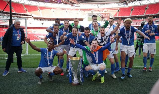 Portsmouth players celebrate winning the EFL Trophy in 2019