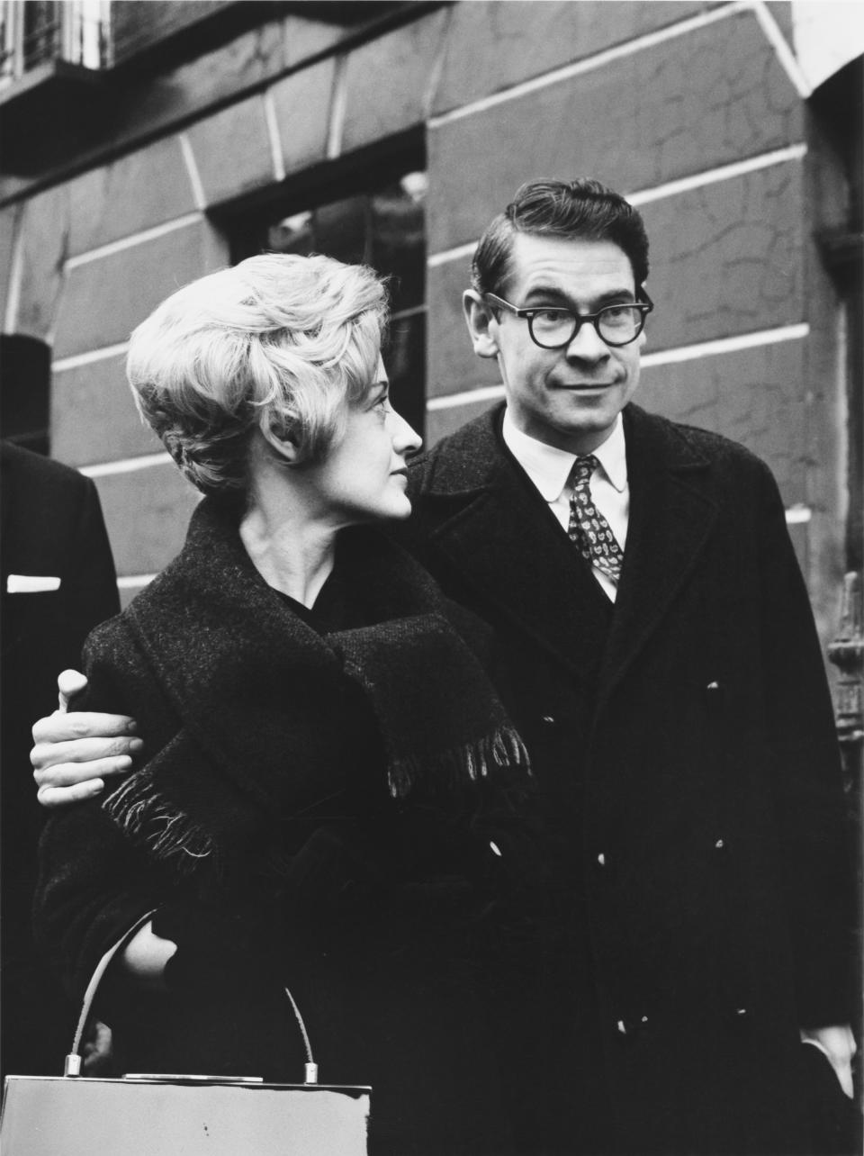 Scottish actor and comedian Stanley Baxter outside the Clerkenwell Magistrates Court in London with his wife Moira, after being cleared of an act of public indecency, 30th March 1962. (Photo by Evening Standard/Hulton Archive/Getty Images)