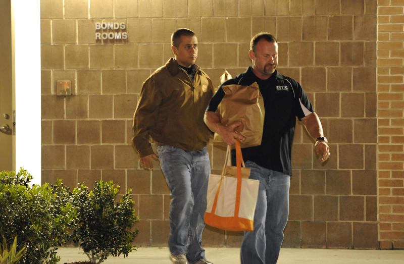George Zimmerman, left, walks out of the intake building at the John E. Polk Correctional Facility with a bondsman on Sunday, April 22, 2012, in Sanford, Fla. Zimmerman posted bail on a $150,000 bond on a second degree murder charge in the February shooting death of 17 year-old Trayvon Martin In Sanford, Fla. (AP Photo/Brian Blanco)