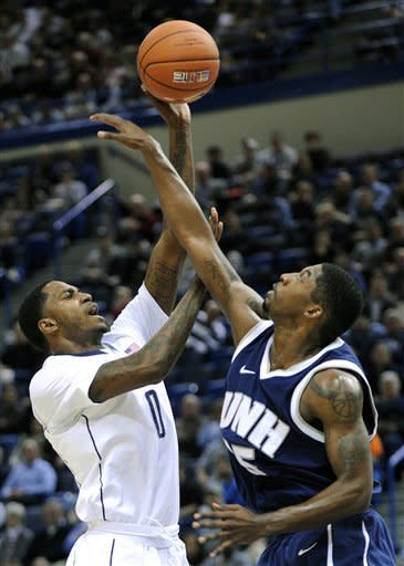Connecticut's Phillip Nolan, left, shoots over New Hampshire's Ferg Myrick during the first half of an NCAA college basketball game in Storrs, Conn., Thursday, Nov. 29, 2012. (AP Photo/Fred Beckham)