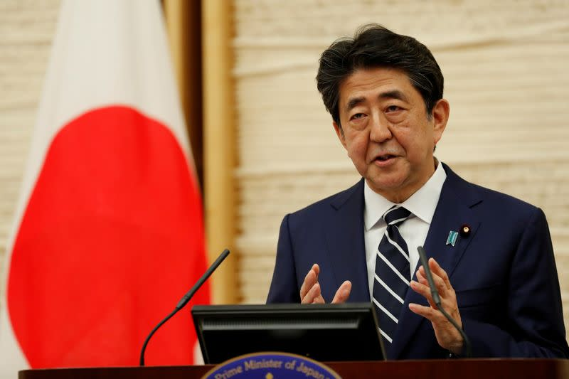 FILE PHOTO: Japan's Prime Minister Shinzo Abe speaks at a news conference in Tokyo