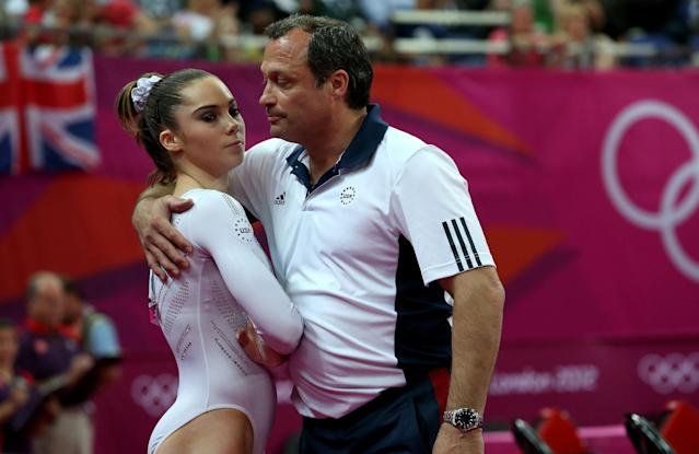 (L-R) McKayla Maroney of the United States looks on as she is consoled by coach Yin Alvarez after she fell on a dismount while competing in the Artistic Gymnastics Women's Vault Final on Day 9 of the London 2012 Olympic Games at North Greenwich Arena on August 5, 2012 in London, England. (Photo by Ronald Martinez/Getty Images)