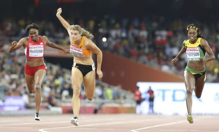 Dafne Schippers from the Netherlands crosses the finish line in front of second placed Elaine Thompson (R) of Jamaica to win the women's 200m event during the 15th IAAF World Championships at the National Stadium in Beijing, China August 28, 2015. REUTERS/Lucy Nicholson