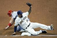 Milwaukee Brewers' Jace Peterson tags ot St. Louis Cardinals' Tommy Edman as he is caught stealing third during the fifth inning of the first game of a baseball doubleheader Wednesday, Sept. 16, 2020, in Milwaukee. (AP Photo/Morry Gash)