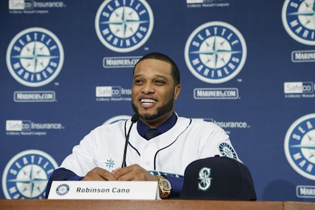 Robinson Cano talks to reporters after he was introduced as the newest member of the Seattle Mariners baseball team on Thursday, Dec. 12, 2013, in Seattle. (AP Photo/Ted S. Warren)