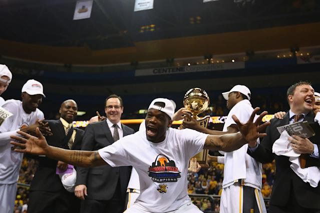 ST. LOUIS, MO - MARCH 9: Chadrack Lufile #0 of the Wichita State Shockers celebrates after beating the Indiana State Sycamores in the MVC Basketball Tournament Championship game at the Scottrade Center on March 9, 2014 in St. Louis, Missouri. The Shockers beat the Sycamores 83-69. (Photo by Dilip Vishwanat/Getty Images)