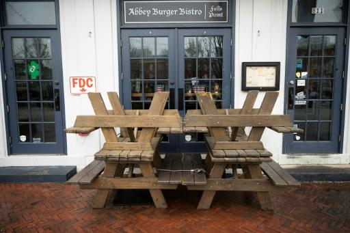 Picnic tables block the closed doors of Abbey burger Bistro in Baltimore, after Maryland Governor Larry Hogan banned on-premises drinking and dining at restaurants