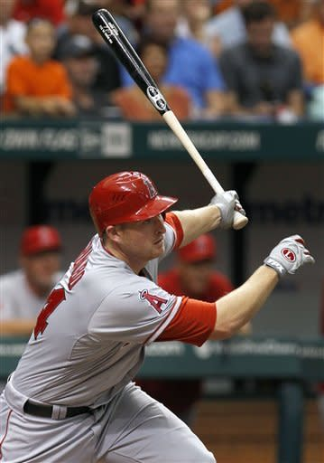 Los Angeles Angels' Mark Trumbo hits an RBI double off Tampa Bay Rays starting pitcher Matt Moore during the sixth inning of a baseball game, Thursday, April 26, 2012, in St. Petersburg, Fla. Angels' Torii Hunter scored on the hit. (AP Photo/Chris O'Meara)
