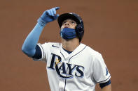 Tampa Bay Rays' Yandy Díaz reacts after his single off New York Yankees starting pitcher Domingo German during the second inning of a baseball game Saturday, April 10, 2021, in St. Petersburg, Fla. (AP Photo/Chris O'Meara)