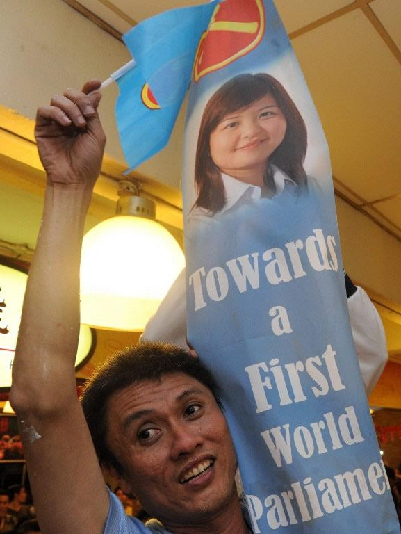 A Workers' Party supporter celebrates after the results for the Punggol east by-election was announced.