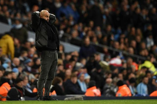 Long way back: Manchester City are 17 points adrift of Premier League leaders Liverpool (AFP Photo/Oli SCARFF )