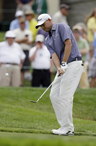Bill Haas chips to the 18th green during the second round of the Memorial golf tournament Friday, May 31, 2013, in Dublin, Ohio. (AP Photo/Darron Cummings)
