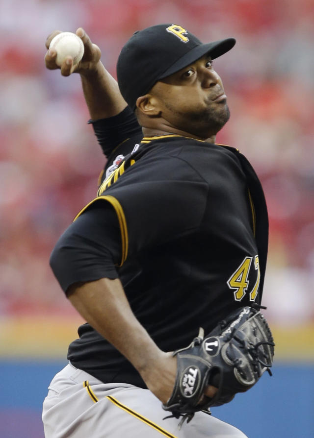 Pittsburgh Pirates starting pitcher Francisco Liriano throws against the Cincinnati Reds in the first inning of a baseball game, Monday, June 17, 2013, in Cincinnati. (AP Photo/Al Behrman)