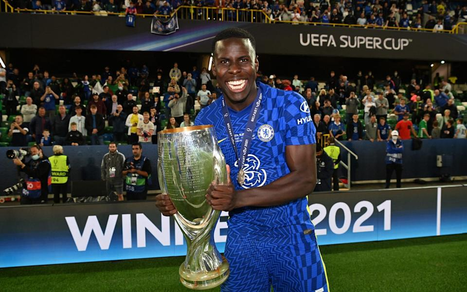 Kurt Zouma of Chelsea celebrates with the UEFA Super Cup Trophy following victory in the UEFA Super Cup 2021 match between Chelsea FC and Villarreal CF at the National Football Stadium at Windsor Park on August 11, 2021 in Belfast, Northern Irelan - Chelsea FC via Getty Images)/Darren Walsh