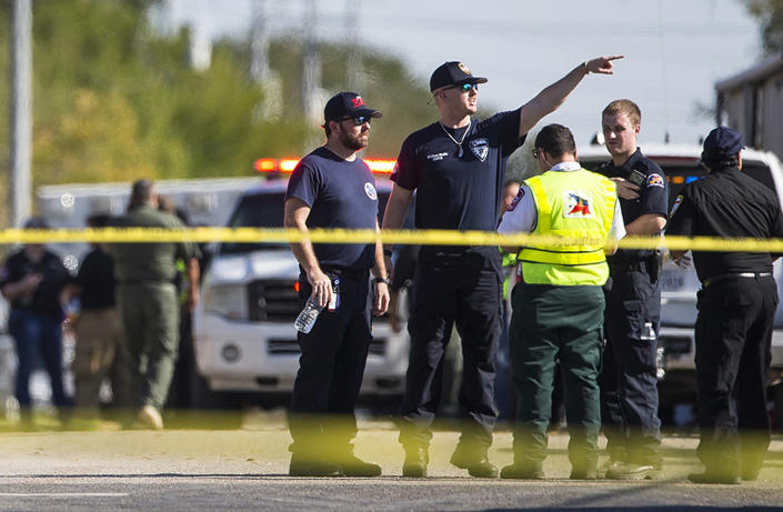 <p>Law enforcement officials work the scene of a fatal shooting at the First Baptist Church in Sutherland Springs, Texas, Nov. 5, 2017. (Nick Wagner/Austin American-Statesman via AP) </p>
