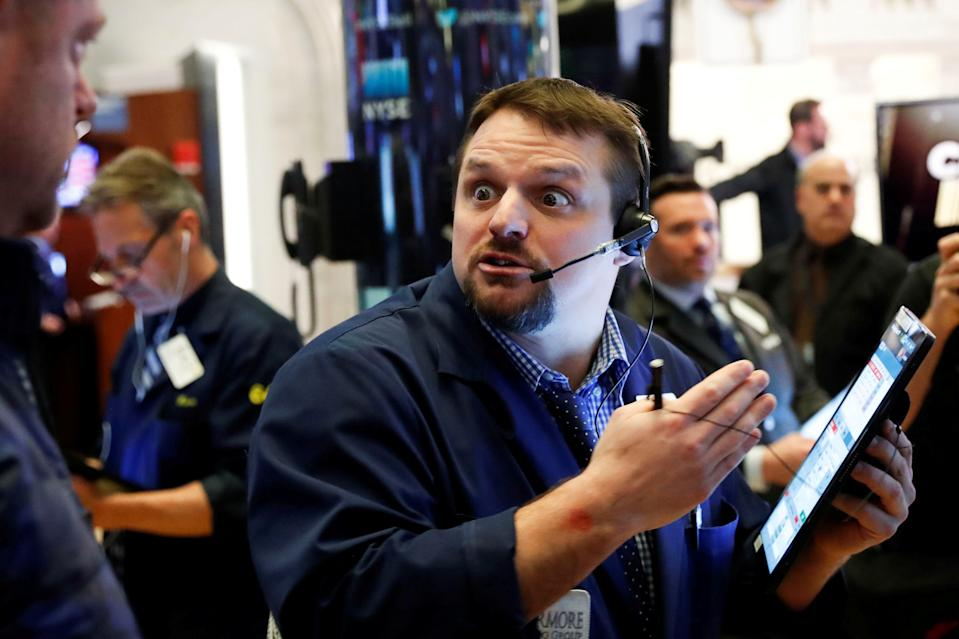 A trader reacts as he works on the floor of the New York Stock Exchange (NYSE) in New York, U.S., March 18, 2020. REUTERS/Lucas Jackson     TPX IMAGES OF THE DAY