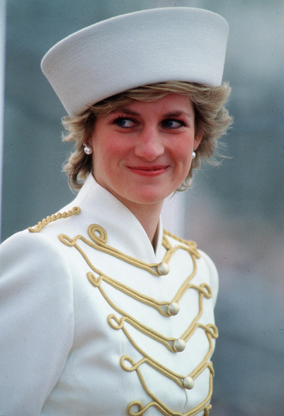 <p>Back in 1987, Princess Diana attended the Sovereigns Parade at the Royal Military Academy in full uniform, her hair tucked neatly beneath a white hat.<br><em>[Photo: PA]</em> </p>