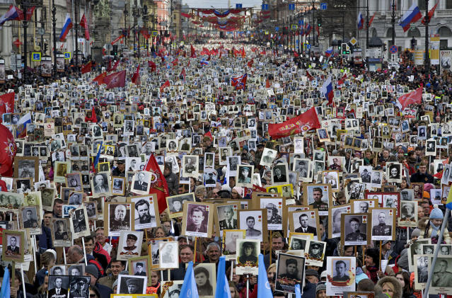 <p>Local residents carry portraits of their ancestors, participants in World War II as they celebrate the 72nd anniversary of the defeat of the Nazis in World War II in St. Petersburg, Russia, on May 9, 2017. About 400,000 people walked in central streets of St. Petersburg in a march named 'Immortal Regiment' while carrying portraits of their relatives who fought in World War II. (Photo: Dmitri Lovetsky/AP) </p>