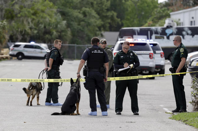 <p>Law enforcement officers, including a K-9 unit, investigate near the scene of a shooting where there were multiple fatalities in an industrial area near Orlando, Fla., Monday, June 5, 2017. The Orange County Sheriff's Office said on its official Twitter account that the situation has been contained. (AP Photo/John Raoux) </p>