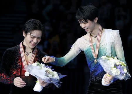 Figure Skating - ISU World Championships 2017 - Men's Victory Ceremony - Helsinki, Finland - 1/4/17 - Gold medallist Yuzuru Hanyu (R) of Japan and his compatriot and silver medallist Shoma Uno attend the ceremony. REUTERS/Grigory Dukor