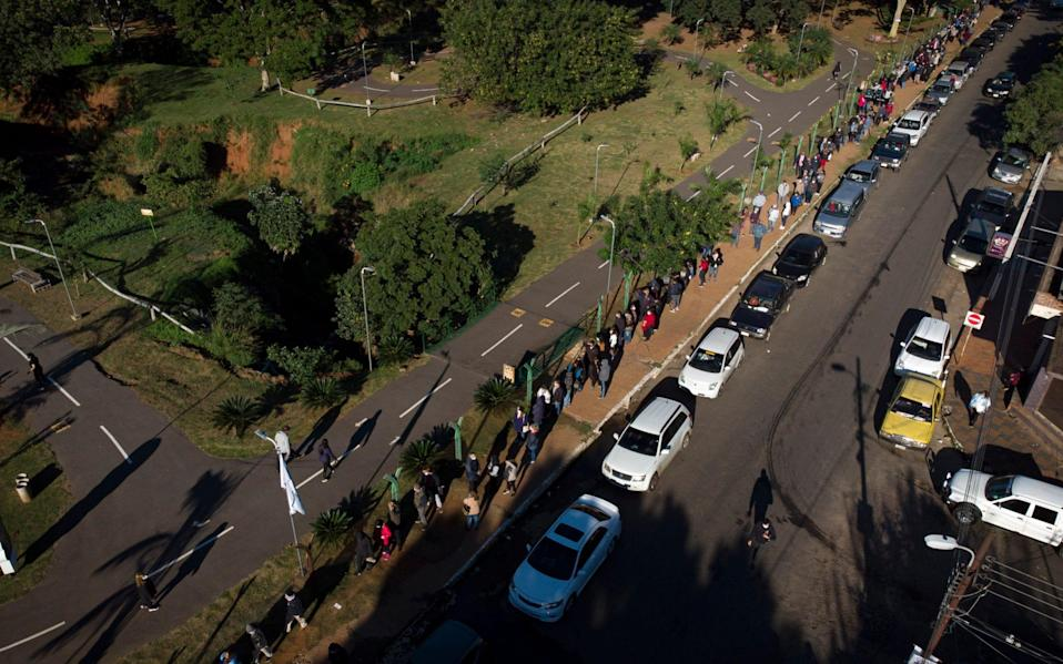 People queue at a vaccination site to get a dose of the AstraZeneca Covid-19 vaccine, in Villa Elisa, Paraguay on June 13 2021 - Jorge Saenz/AP