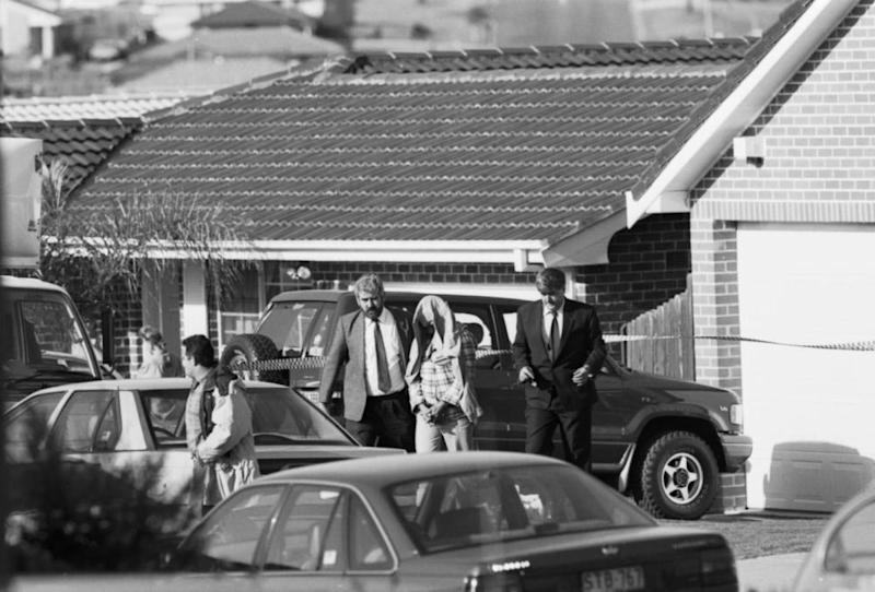 Detectives take Milat into custody after raiding his home in Eagle Vale, Sydney, in May 1994