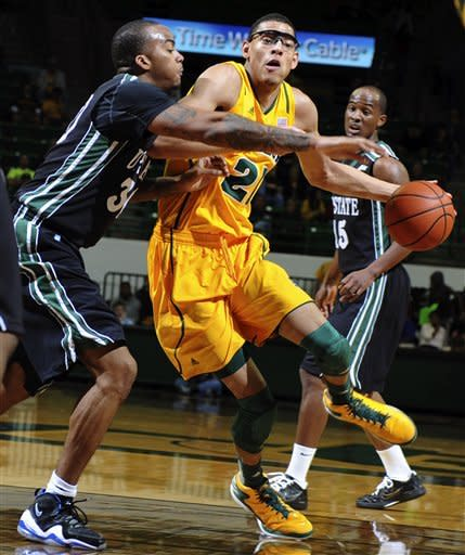 Baylor's Isaiah Austin (21) drives on South Carolina-Upstate's Rob Elam (30) during the first half of an NCAA college basketball game, Monday, Dec. 17, 2012, in Waco, Texas. (AP Photo/The Waco Tribune-Herald, Rod Aydelotte)