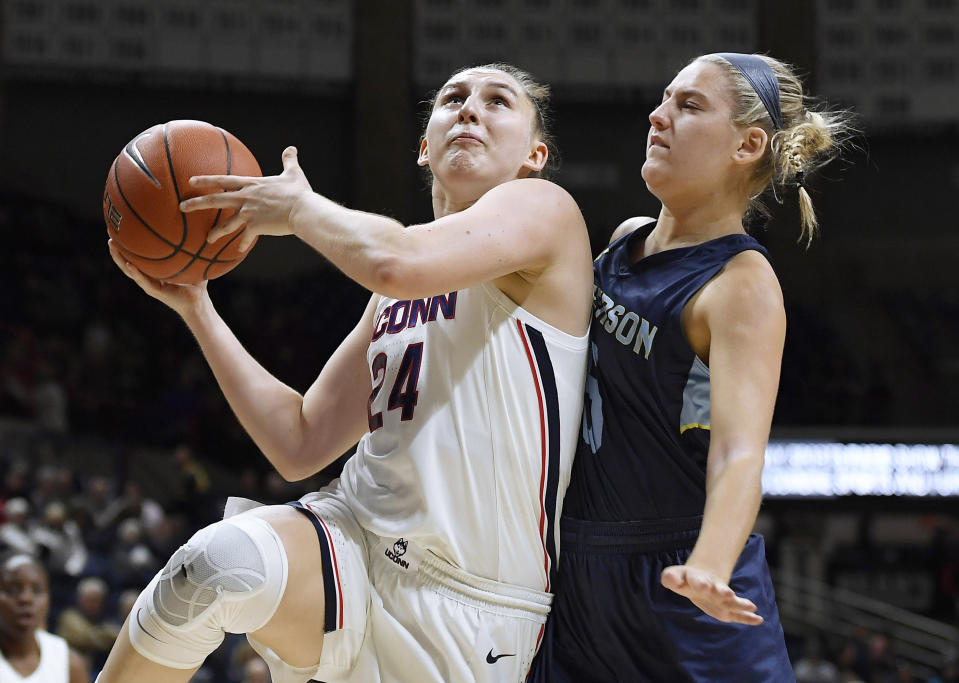 Connecticut's Anna Makurat looks to shoot as Jefferson's Bridget Arcidiacono, right, defends during the second half of an NCAA college exhibition basketball game, Sunday, Nov. 3, 2019, in Storrs, Conn. (AP Photo/Jessica Hill)