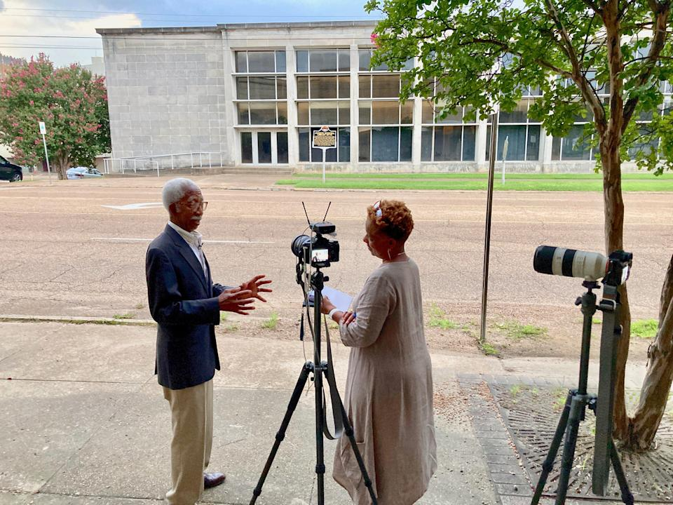 USA TODAY journalist Deborah Berry, right, speaks with Jerry Keahey, who drove the Tougaloo Nine in 1961.
