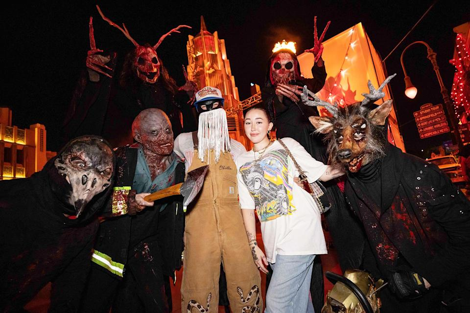 <p>making some new friends at Halloween Horror Nights at Universal Studios Hollywood on Sept. 10.</p>