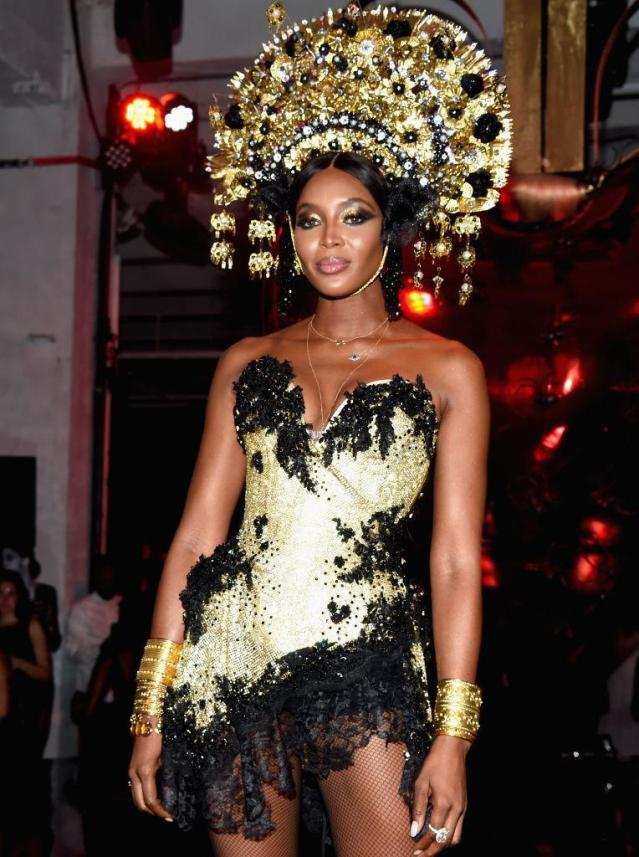 <p>Naturally, Campbell looked amazing! She sparkled too in a fierce gold headdress at an amfAR party in NYC. (Photo: Kevin Tachman/amfAR2017/WireImage) </p>