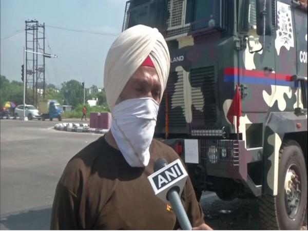 Officer Karnail Singh with the Command Vehicle (Photo/ANI)