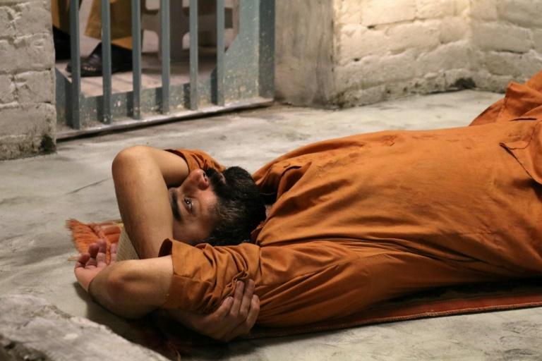 """The project dubbed 'No Time to Sleep' saw actor Sarmad Khoosat embody 'Prisoner Z' in his last hours in this world  This handout photo taken on October 10, 2018 and released by Justice Project Pakistan shows a performance by Pakistani artist Sarmad Khoosat during a 24-hour live performance as """"Prisoner Z"""" in isolation, in Lahore.The project, dubbed """"No Time to Sleep"""", saw actor Sarmad Khoosat embody """"Prisoner Z"""", locked in isolation for his last hours in this world, in a live-streamed 24-hour performance which ended at the stroke of midnight on October 10"""