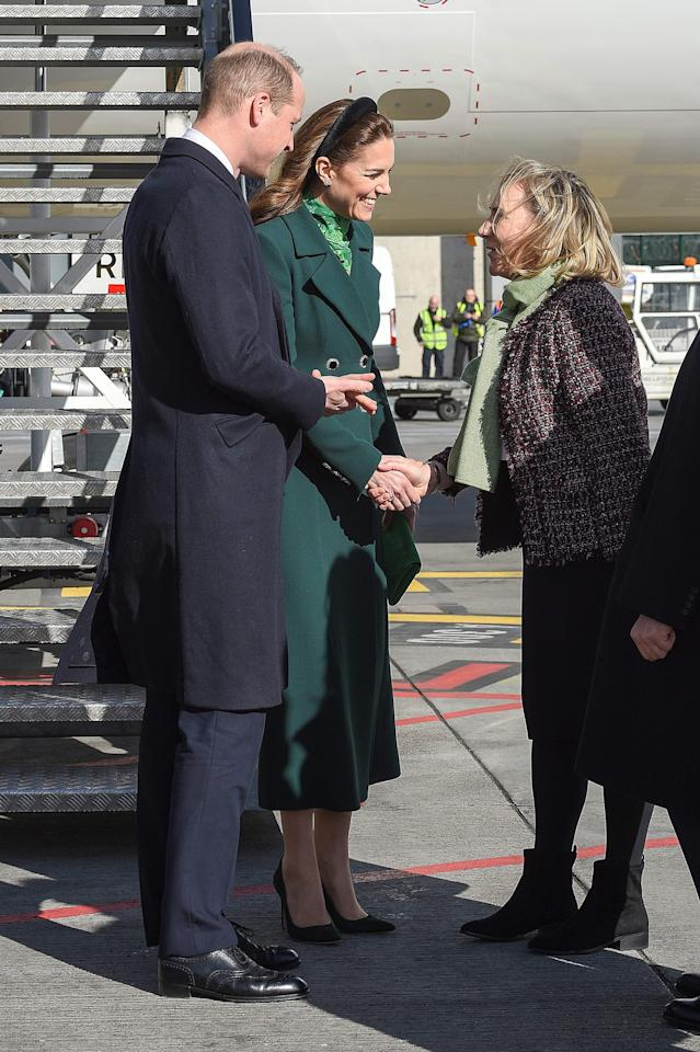 Britain's Prince William, Duke of Cambridge (L), and Catherine, Duchess of Cambridge (2L), are greeted as they arrive at Dublin International Airport in Dublin on March 3, 2020 at the start of a three-day visit. (Photo by Michael CHESTER / POOL / AFP) (Photo by MICHAEL CHESTER/POOL/AFP via Getty Images)