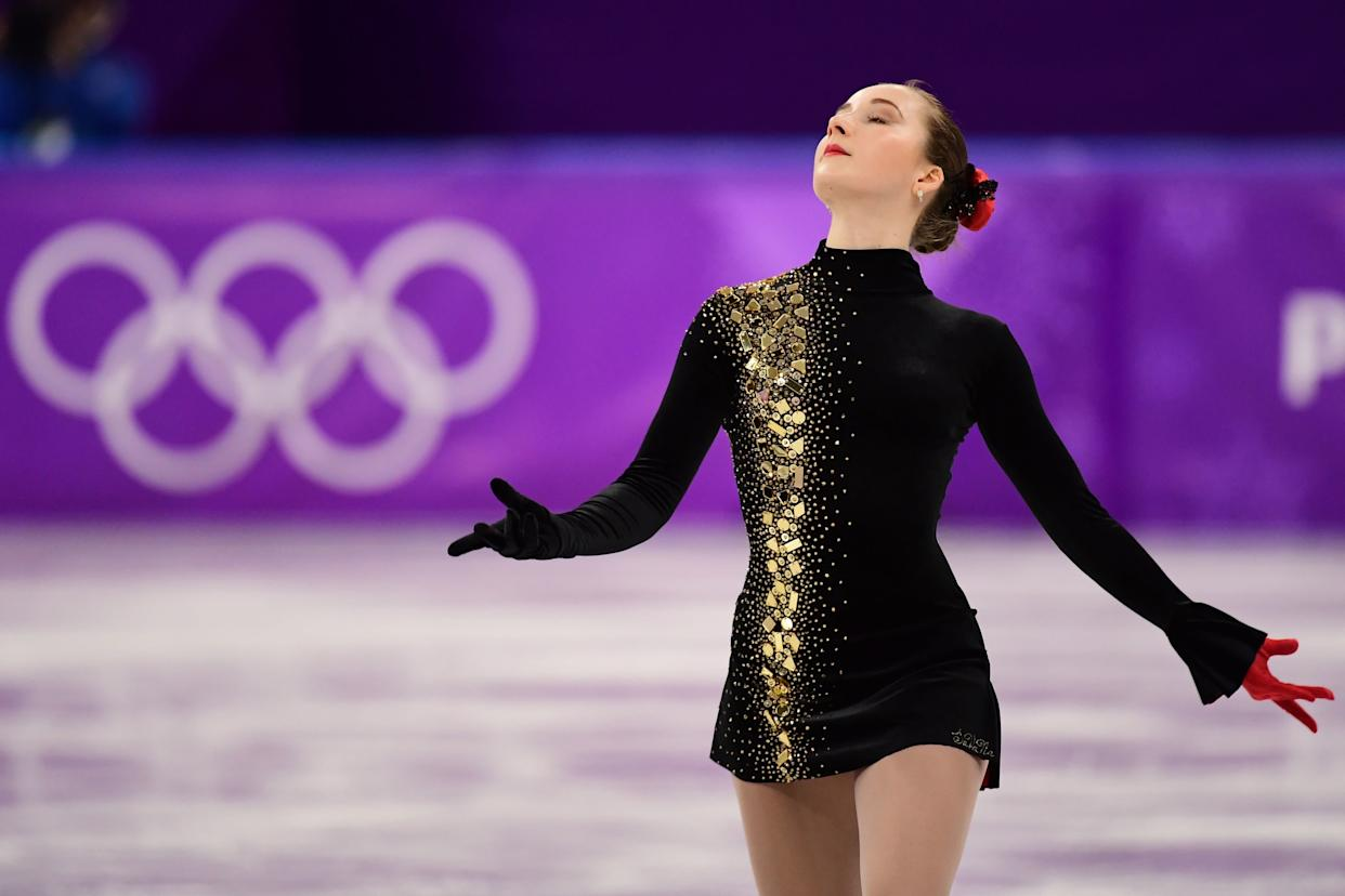 As far as figure skating costumes go, the Ukrainian athlete's is quite conservative. But that's what we love about it -- it's classy and dramatic (but not over-the-top), and the red glove is anice touch.