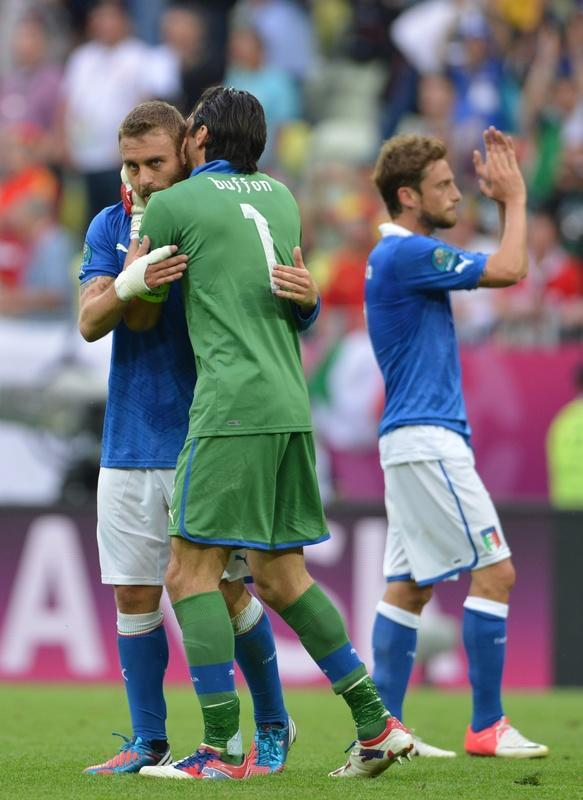Italian goalkeeper Gianluigi Buffon (C) congratulates teammates at the end of the Euro 2012 championships football match Spain vs Italy on June 10, 2012 at the Gdansk Arena. The game ended in a draw 1-1. AFPPHOTO/ GIUSEPPE CACACEGIUSEPPE CACACE/AFP/GettyImages