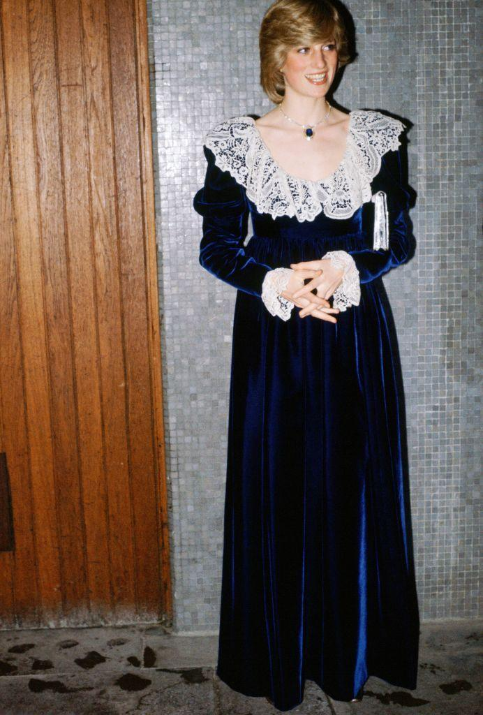 <p>The Princess of Wales at the National Film Institute Dinner at the Royal Festival Hall, in December 1981 wearing a blue velvet dress with an oversized white lace collar and ruffled cuff embellishment.</p>