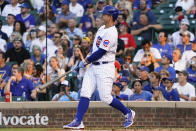 Chicago Cubs' Anthony Rizzo watches his two-run home run against the Cincinnati Reds during the first inning of a baseball game Tuesday, July 27, 2021, in Chicago. (AP Photo/David Banks)
