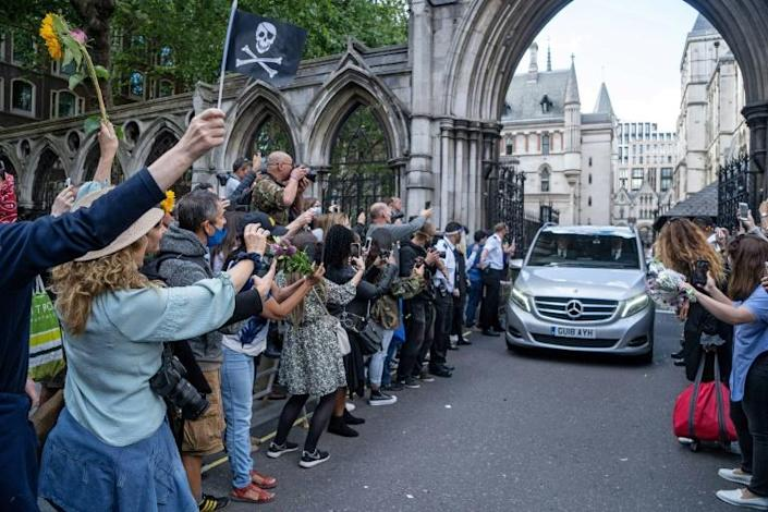 """The """"Pirates of the Caribbean"""" franchise hero was mobbed by fans chanting """"Justice for Johnny"""" and trying to pass him bouquets (AFP Photo/Niklas HALLE'N)"""