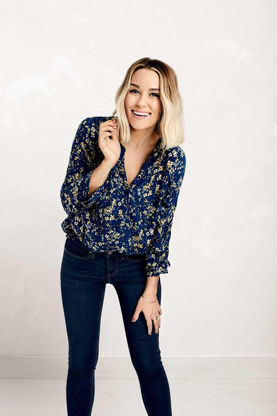 Lauren Conrad in a floral blouse and dark denim jeans from the LC Lauren Conrad collection with Kohl's. (Photo: Courtesy of LC Lauren Conrad/Kohl's)