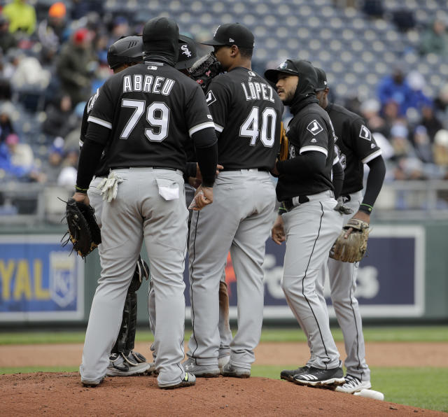 Chicago White Sox players meet on the mound after allowing a run during the third inning of a baseball game against the Kansas City Royals Saturday, March 30, 2019, in Kansas City, Mo. (AP Photo/Charlie Riedel)