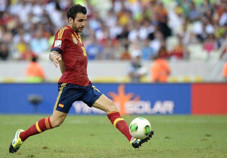 Cesc Fabregas drives the ball against Nigeria, at the Castelao Stadium in Fortaleza on June 23, 2013