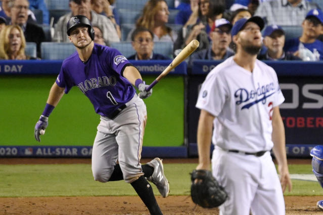 Colorado Rockies' Garrett Hampson runs to first after hitting a home run off Los Angeles Dodgers starting pitcher Clayton Kershaw, right, during the fourth inning of a baseball game Friday, Sept. 20, 2019, in Los Angeles. (AP Photo/Mark J. Terrill)