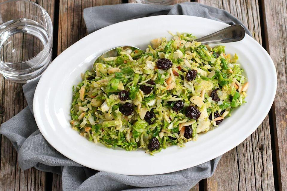 """<p>These thinly sliced Brussels sprouts make the perfect base for any mix-in. Choose from five fun combos, including bacon and thyme or dried cherries and almonds. </p><p><strong>Get the recipe from <a href=""""https://www.thepioneerwoman.com/food-cooking/recipes/a90194/5-ways-to-serve-sauteed-brussels-sprouts/"""" rel=""""nofollow noopener"""" target=""""_blank"""" data-ylk=""""slk:Dara Michalski"""" class=""""link rapid-noclick-resp"""">Dara Michalski</a>.</strong></p>"""