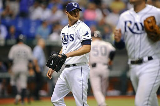 Tampa Bay Rays starting pitcher Alex Cobb, center, walks to the dugout during the seventh inning of a baseball game against the New York Yankees, Wednesday, April 24, 2013, in St. Petersburg, Fla. (AP Photo/Brian Blanco)