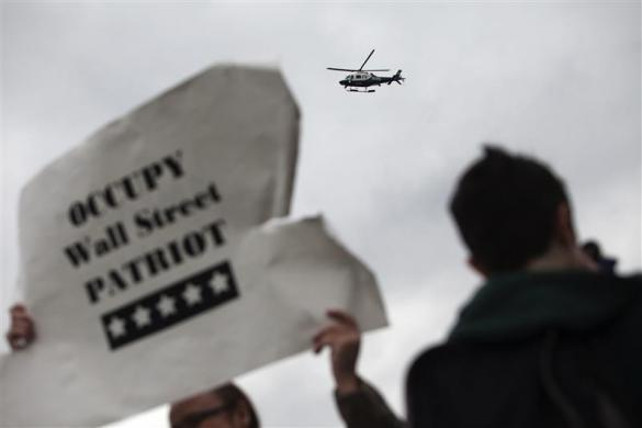 A New York police department helicopter monitors an Occupy Wall Street protest march in New York April 1, 2012.