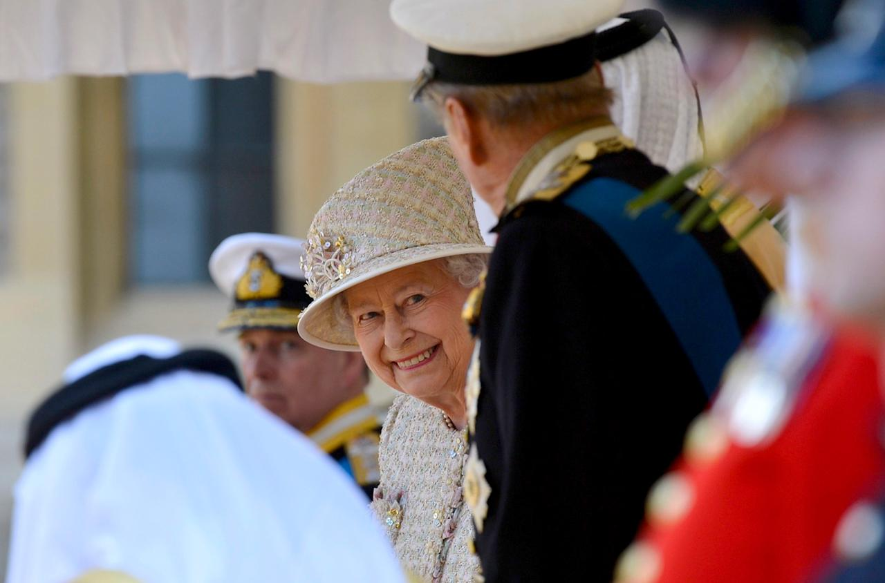 WINDSOR, ENGLAND - APRIL 30:  Queen Elizabeth II smiles during a ceremonial welcome for President of the United Arab Emirates, His Highness Sheikh Khalifa bin Zayed Al Nahyan on April 30, 2013 in Windsor, England. President Sheikh Khalifa begins a State visit to the UK today, the first for a UEA President in 24 years. Sheikh Khalifa will meet the British Prime Minister David Cameron tomorrow at his Downing Street residence.  (Photo by Toby Melville - WPA Pool/Getty Images)