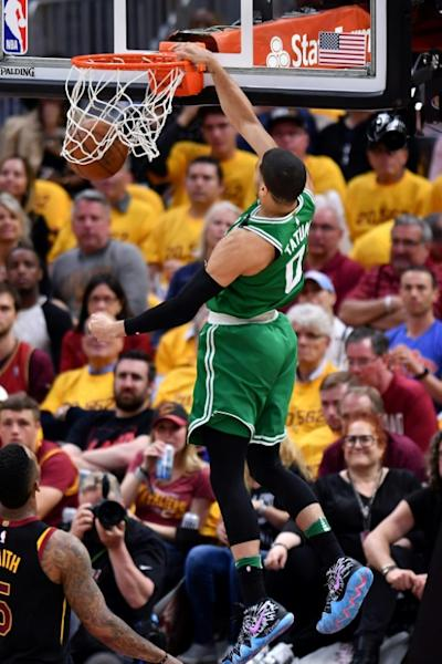 Jayson Tatum of the Boston Celtics dunks against the Cleveland Cavaliers during game four of the Eastern Conference Finals