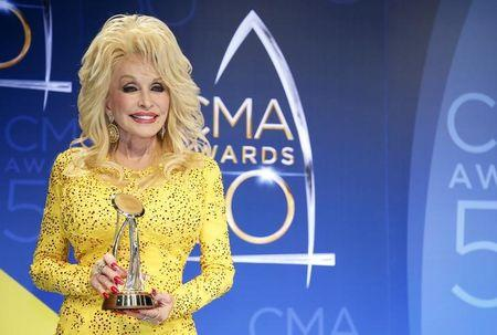 Dolly Parton poses with her award during the 50th Annual Country Music Association Awards in Nashville