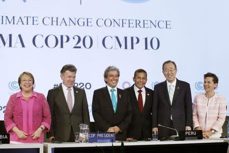 """(L to R) Chile's President Michelle Bachelet, Colombia's President Juan Manuel Santos, Peru's Environment Minister Manuel Pulgar Vidal, Peru's President Ollanta Humala, United Nations Secretary-General Ban Ki-moon and Christiana Figueres, Executive Secretary, United Nations Framework Convention on Climate Change (UNFCCC), pose for the media during the High Level Segment of the U.N. Climate Change Conference COP 20 in Lima, December 10, 2014. The two-week long United Nations climate summit opened on December 1 in Lima, with experts and analysts from around the world gathering to discuss melting glaciers and extreme weather patterns. Ban Ki-moon, expressed deep concern about slow action to combat climate change, told governments at U.N. talks in Lima on Tuesday there was no """"time for tinkering"""" and urged a radical shift to greener economies. REUTERS/Enrique Castro-Mendivil"""